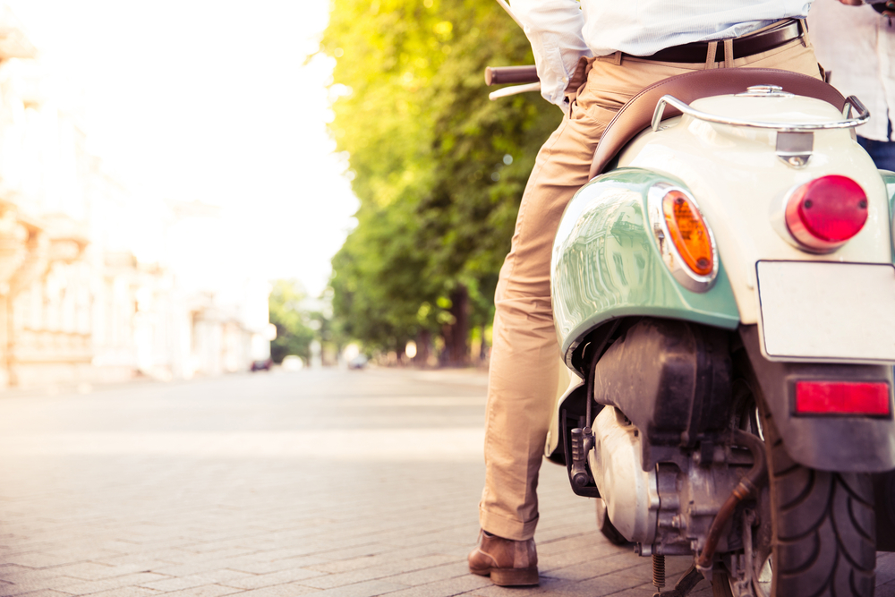 Closeup portrait of a scooter with male legs outdoors
